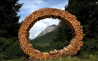 """Letter """"O"""" made from pieces of chopped wood"""